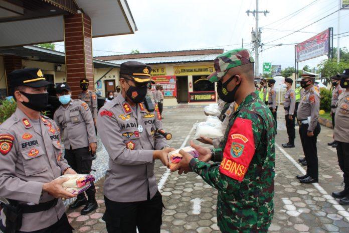 Kepedulian TNI Polri Terhadap Masyarakat yang Terdampak Covid 19